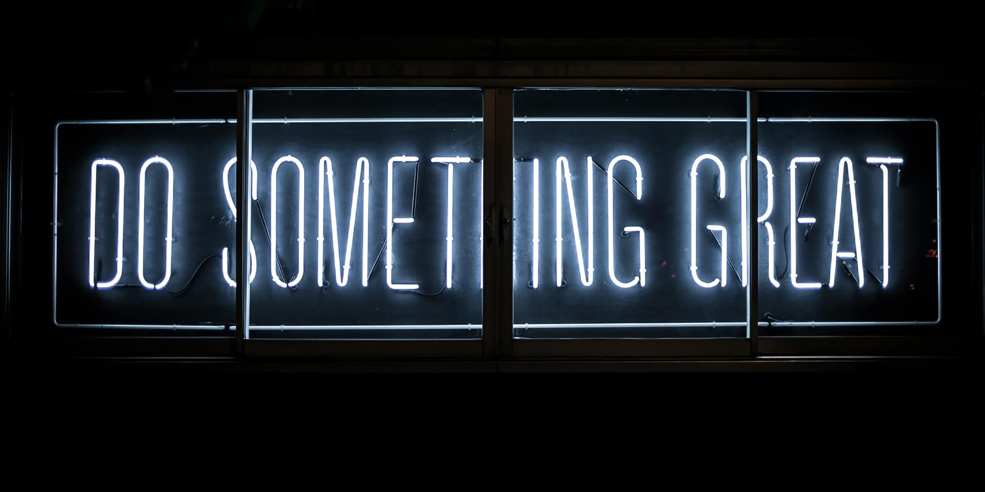 Neon light sign that reads Do something great